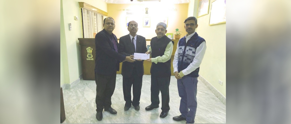 Faculty members of the Sreehatta  Sanskrit College, Sylhet presenting AHC Mr Krishnamurthy a letter of thanks on behalf of the Board of Directors appreciating AHCI's assistance with furniture to the college.